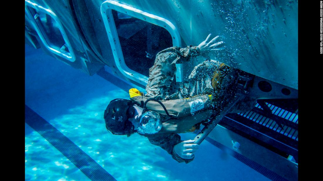 A US Marine trains in an underwater simulator Friday, February 9, at California's Camp Pendleton. The simulator resembles a helicopter and is used to train Marines on how to escape if their helicopter crashes in the water.