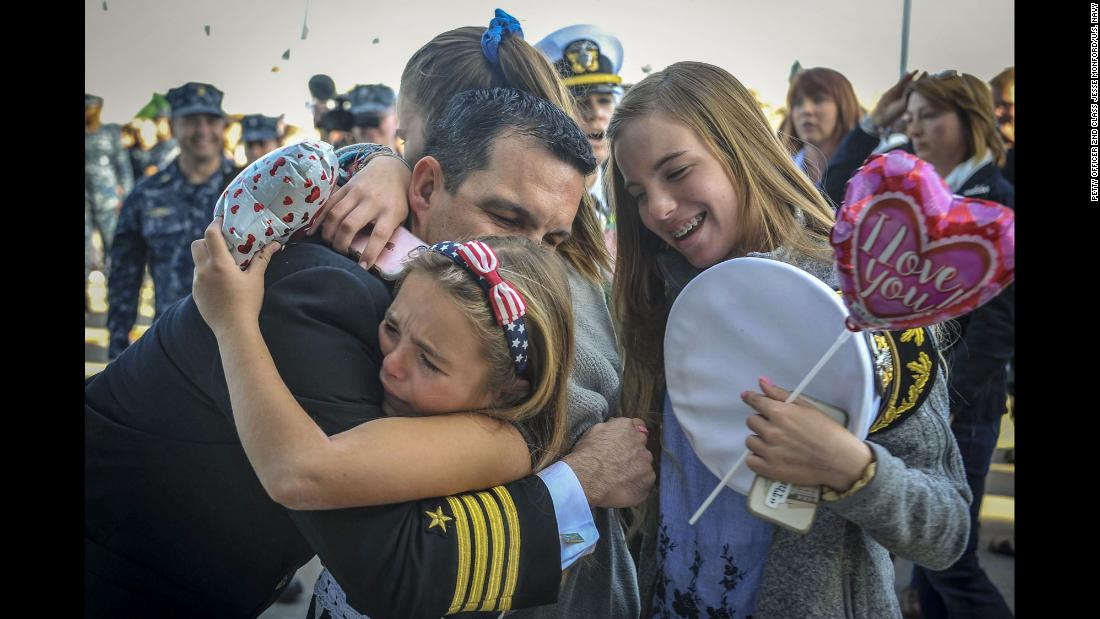 Navy Capt. Rome Ruiz greets his family in San Diego during the homecoming of the USS America on Friday, February 2. The amphibious assault ship was returning from a deployment to the Western Pacific and Middle East.