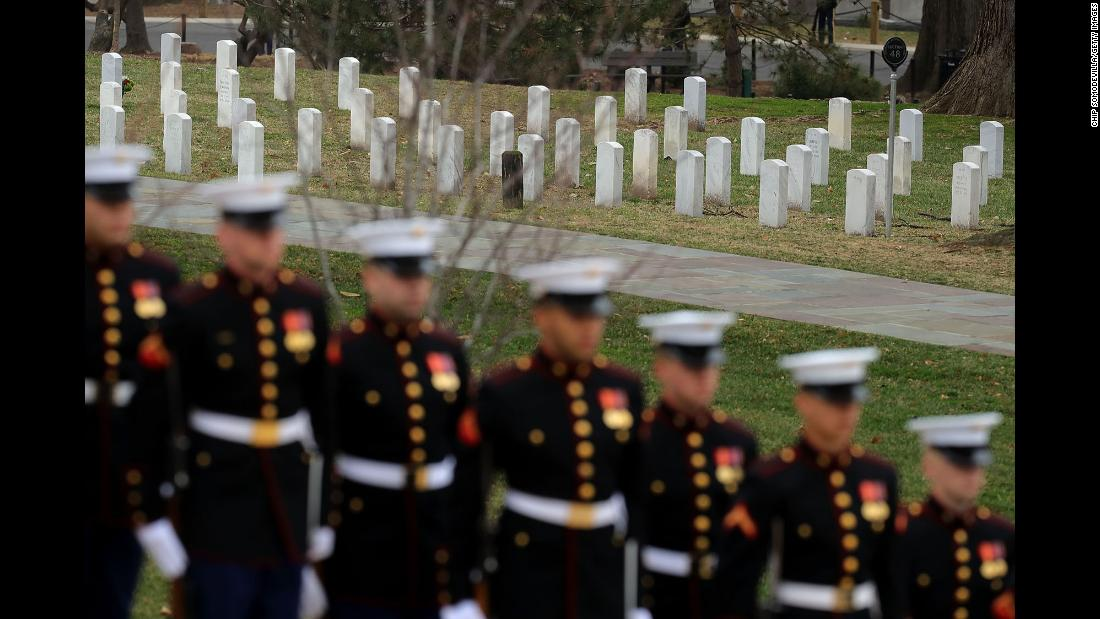 US Marines await the arrival of Australian Prime Minister Malcolm Turnbull, who was visiting Arlington National Cemetery in Virginia on Thursday, February 22. Turnbull and his wife stopped at the grave of Royal Australian Air Force pilot Francis D. Milne, the only Australian buried at the cemetery.