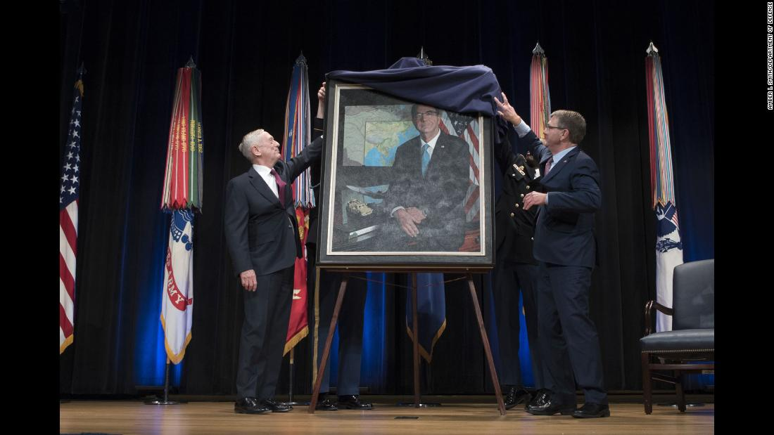 Defense Secretary James Mattis, left, and his predecessor, Ash Carter, unveil Carter's official portrait during a ceremony at the Pentagon on Friday, February 2.
