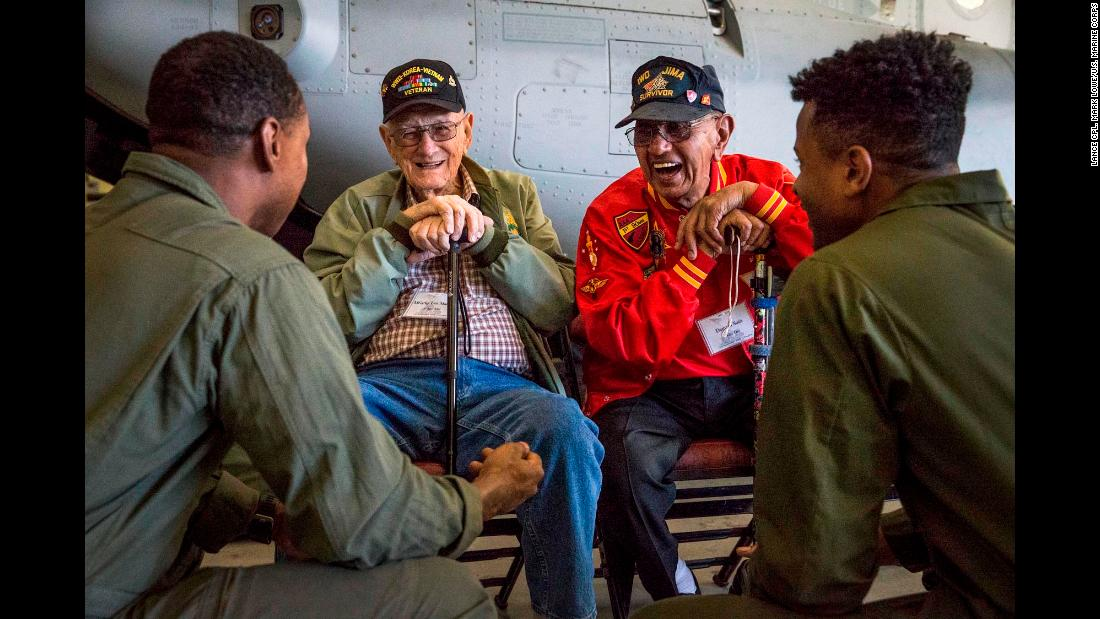 Retired US Marines Len Maffioli and Damaso Sutis share stories with active-duty Marines at an air station in Miramar, California, on Friday, February 16. Maffioli and Sutis fought in the Battle of Iwo Jima, which began in February 1945.
