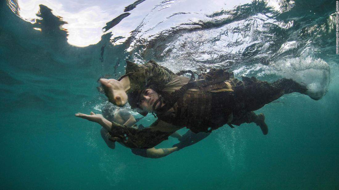 Navy Petty Officer 2nd Class Richard N. Zealy swims in Apra Harbor during a training exercise in Guam on Friday, February 2.