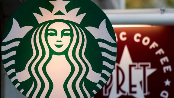 Logos are pictured on signs outside Starbucks (L) and Pret a Manger coffee shops in London on November 15, 2017.   / AFP PHOTO / Justin TALLIS        (Photo credit should read JUSTIN TALLIS/AFP/Getty Images)
