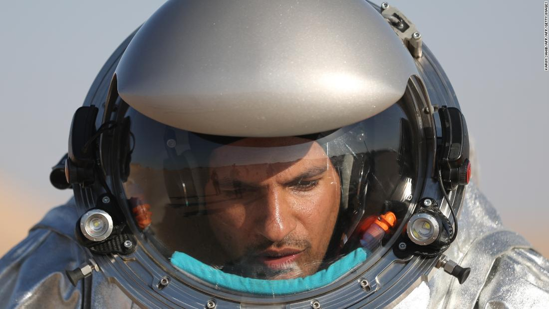 An AMADEE-18 analog astronaut heads out to conduct experiments in Oman's Dhofar region.