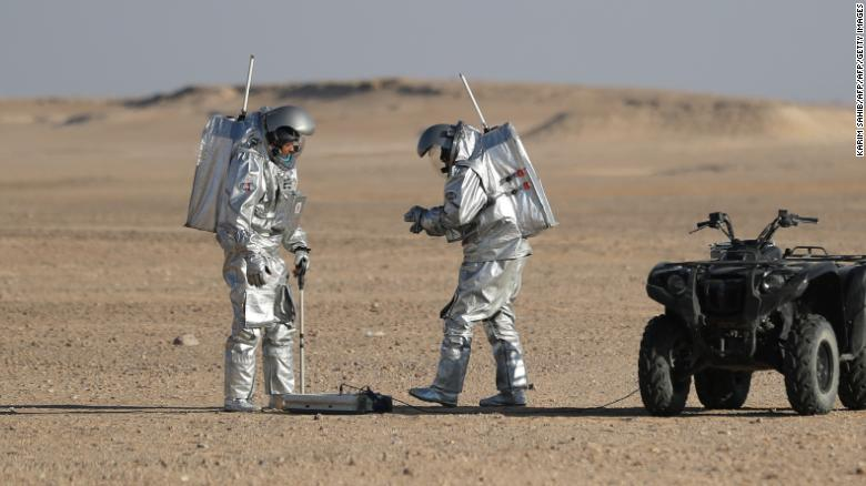 Members of the AMADEE-18 Mars simulation mission wear spacesuits while conducting scientific experiments during an analog field simulation in Oman's Dhofar desert on February 7, 2018, in a collaboration between the Austrian Space Forum and the Oman National Steering Comittee preparing for future human Mars missions.