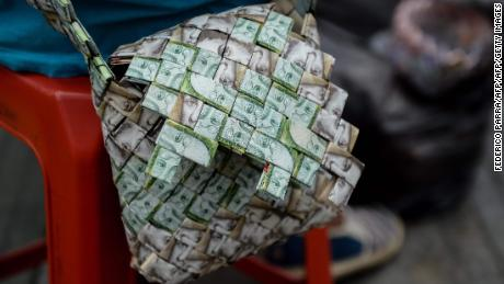 Closeup of a purse made by Venezuelan Wilmer Rojas, out of Bolivar banknotes in Caracas on January 30, 2018. A young Venezuelan tries to make a living out of devalued Bolivar banknotes by making crafts with them.  / AFP PHOTO / FEDERICO PARRA / TO GO WITH AFP STORY by Margioni BERMUDEZ        (Photo credit should read FEDERICO PARRA/AFP/Getty Images)