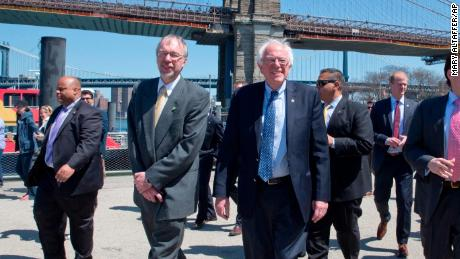 Democratic presidential candidate Bernie Sanders, I-Vt., and his son Levi Sanders, left, take a walk in Brooklyn Bridge park, Sunday, April 17, 2016, in the Brooklyn borough of New York. (AP Photo/Mary Altaffer)