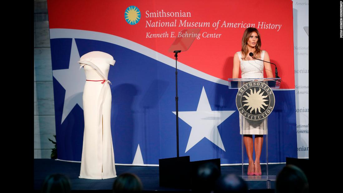 "Trump speaks at an October ceremony after <a href=""https://www.cnn.com/2017/10/18/politics/melania-trump-gown-smithsonian/index.html"" target=""_blank"">donating her inaugural gown</a> to the National Museum of American History. It will be part of the museum's First Ladies Collection."