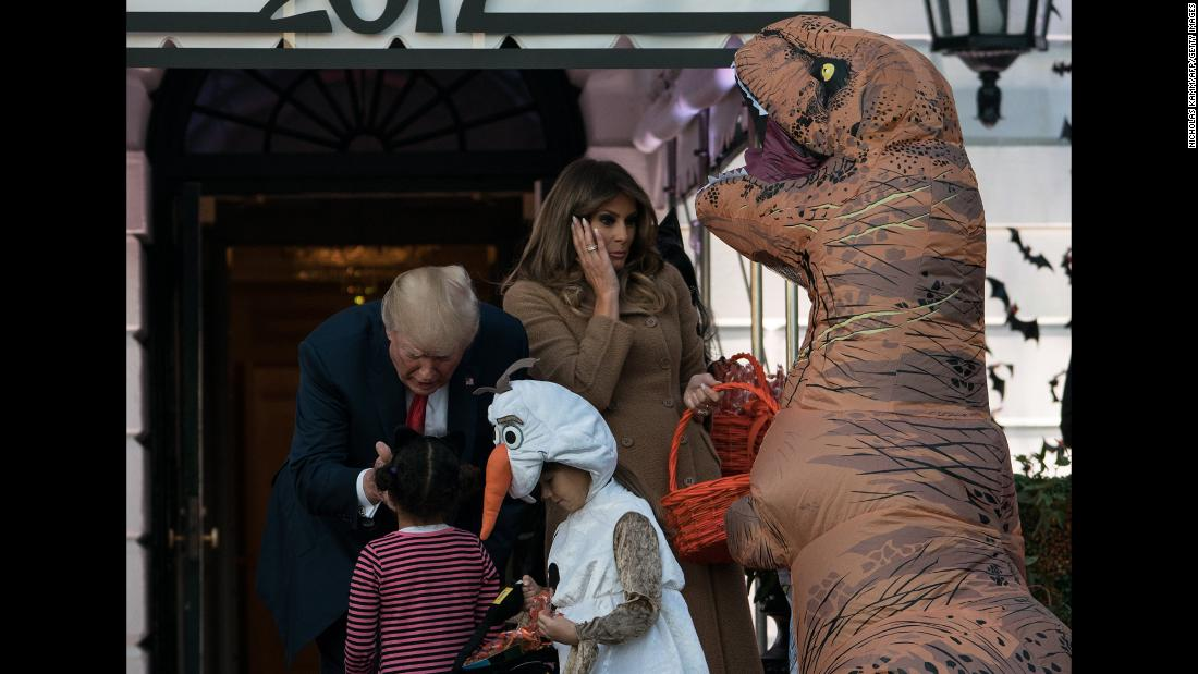 "The Trumps hand out candy to children during a White House <a href=""https://www.cnn.com/videos/politics/2017/10/31/trump-white-house-halloween-erin-moos-pkg.cnn"" target=""_blank"">Halloween event.</a>"