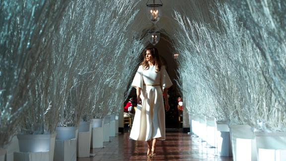 """Trump walks through <a href=""""https://www.cnn.com/2017/11/27/politics/melania-trump-white-house-holiday-decorations/index.html"""" target=""""_blank"""">Christmas decorations</a> at the White House."""
