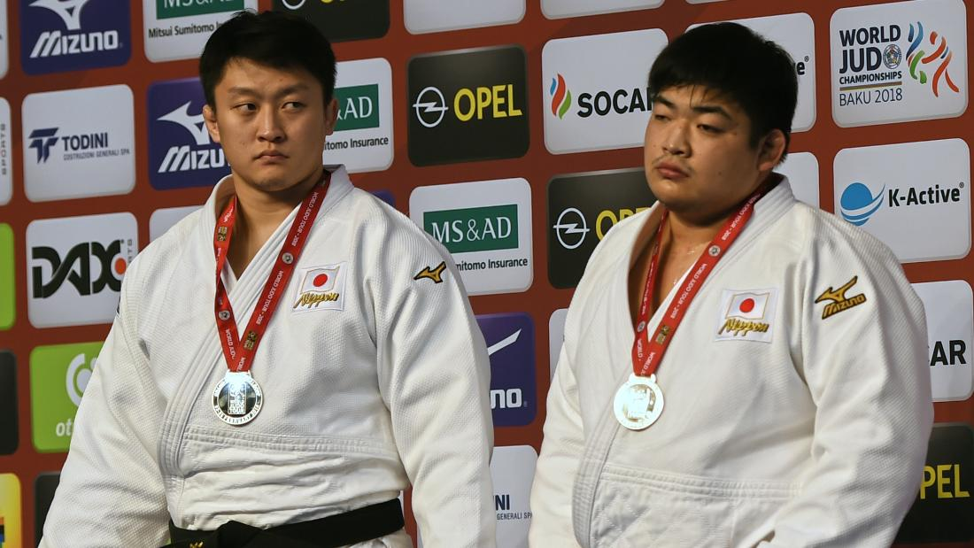 Japanese judoka Hisayoshi Harasawa (L) and Takeshi Ojitani (R) contested the heavyweight final at the inaugural Dusseldrof Grand Slam, but neither man won.