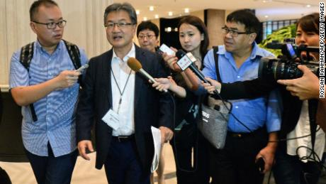 US Special Representative for North Korea Policy Joseph Yun (2nd L) is surrounded by the media as he walks out for his lunch break during the Northeast Asia Cooperation Dialogue (NEACD) in Singapore on July 11, 2017.  Yun is in Singapore to attend the Northeast Asia Cooperation Dialogue (NEACD) from July 11 to 13. / AFP PHOTO / Roslan RAHMAN        (Photo credit should read ROSLAN RAHMAN/AFP/Getty Images)