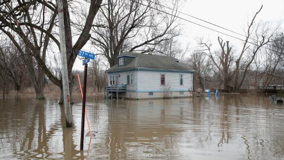 Floodwaters surround a home on February 22 in Lake Station, Indiana.