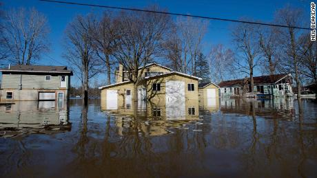 Flooding along Riverbank Avenue on Monday in Plainfield Township, Michigan.