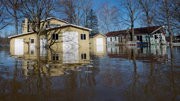 Floodwaters surround homes in  Plainfield Township, Michigan, on Monday.