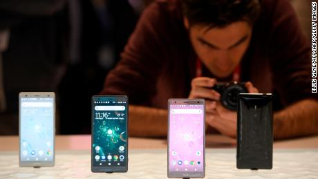 A man takes pioctures of Sony Xperia XZ2 mobilephones at the Mobile World Congress (MWC), the world's biggest mobile fair, on February 26, 2018 in Barcelona. The Mobile World Congress is held in Barcelona from February 26 to March 1. / AFP PHOTO / LLUIS GENE        (Photo credit should read LLUIS GENE/AFP/Getty Images)