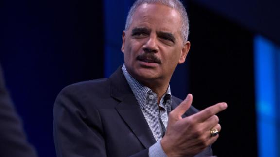 "Former U.S. Attorney General Eric Holder speaks during an interview at the Washington Post on February 27, 2018 in Washington, DC.  During an interview with Washington Post writer Jonathan Capehart, Holder discussed Special Counsel Robert Muller's investigation into alleged Russian meddling in the 2016 US presidential election, as well as his efforts to reform what he calls the ""biggest rigged system in America"" through a national redistricting effort. (Photo by Toya Sarno Jordan/Getty Images)"