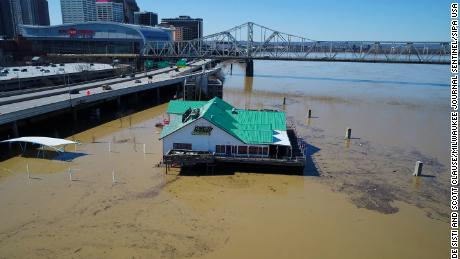 The Joe's Crab Shack in Louisville, Kentucky, sits surrounded by water along the Ohio River.