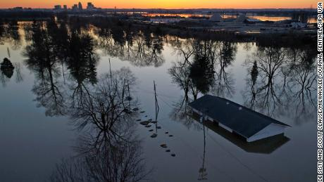 This drone photograph shows a structure submerged by floodwaters in Louisville.