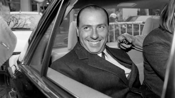 Berlusconi leaves a 1985 news conference in Paris.