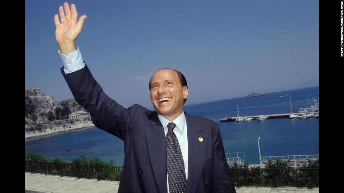 Berlusconi waves while attending a European Council meeting in Corfu, Greece, in June 1994.