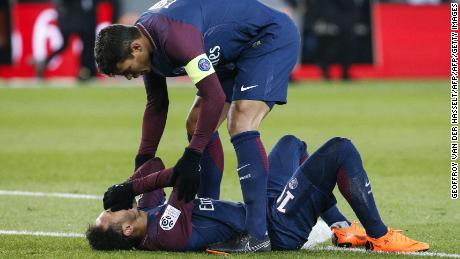Neymar is comforted by PSG's Brazilian defender Thiago Silva.