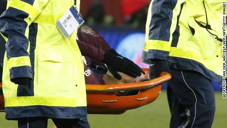 Neymar is stretchered off during PSG's game against Marseille on Sunday.