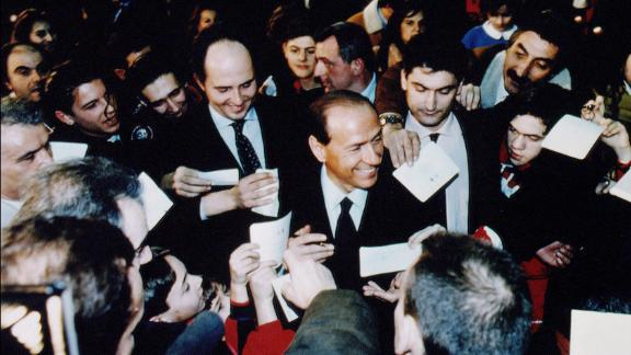 Berlusconi is surrounded by supporters during a rally in Rome in February 1994.