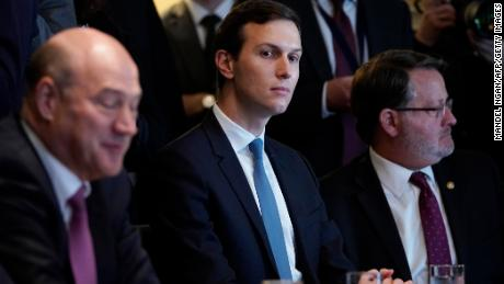 From left: Director of the National Economic Council Gary Cohn, Senior Advisor Jared Kushner, and Sentor Gary Peters, D-MI, take part in a meeting with US President Donald Trump and members of Congress on trade in the Cabinet Room of the White House on February 13, 2018 in Washington, DC. (MANDEL NGAN/AFP/Getty Images)