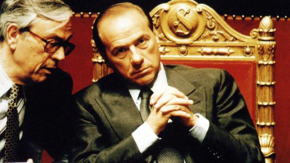 Berlusconi chats with lawmaker Cesare Previti at the Italian Senate during a vote of confidence for Berlusconi's government on May 17, 1994.