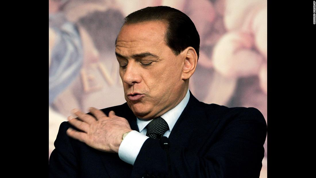 Berlusconi wipes his jacket during a news conference in Rome in 2006. He lost the election that year to Romano Prodi.