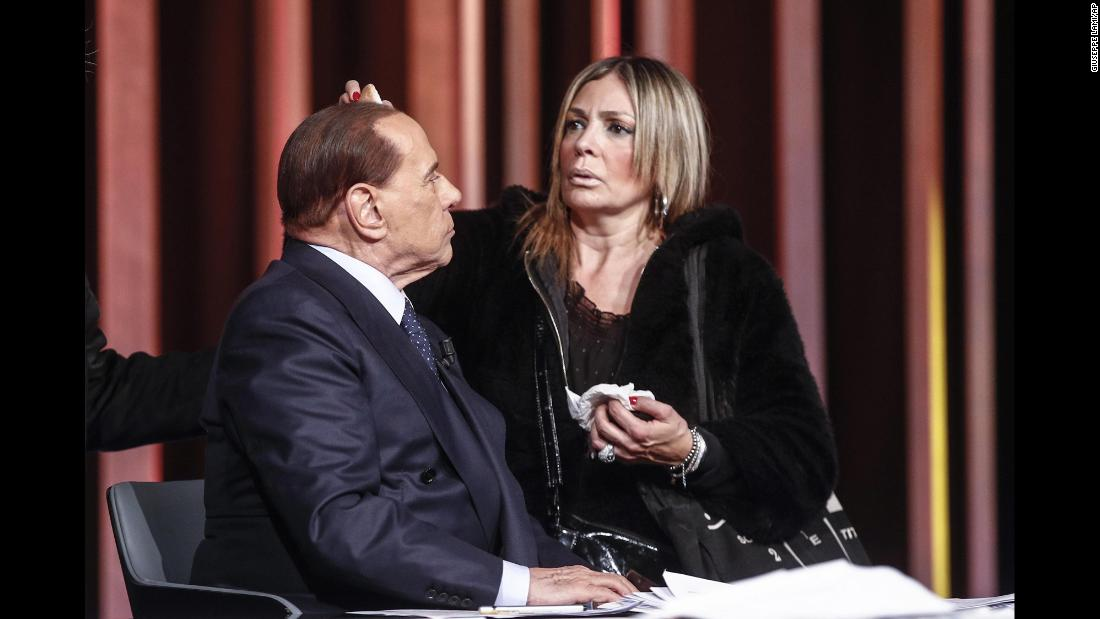 Berlusconi has makeup applied before a television appearance in February 2018.