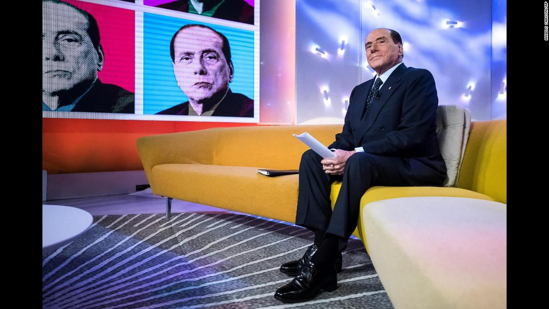 "Berlusconi appears on the television program ""Tagada"" in February 2018. Italy will hold general elections on March 4, and Berlusconi, as leader of the Forza Italia party, has brokered a right-wing alliance with the neo-fascist Brothers of Italy party and the anti-immigrant Northern League."