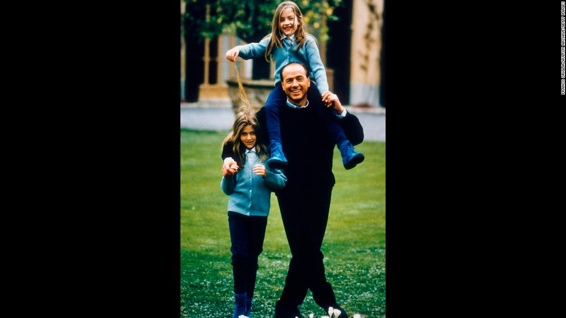 Berlusconi plays with daughters Barbara, left, and Eleonora in Milan.