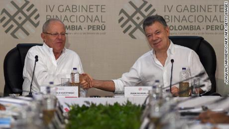 Colombian President Juan Manuel Santos (R) shakes hands with his Peruvian counterpart Pedro Pablo Kuczynski during the 4th Colombia-Peru Binational Cabinet meeting being held in the Colombian Caribbean port city of Cartagena, on February 27, 2018.  / AFP PHOTO / Joaquin SARMIENTO        (Photo credit should read JOAQUIN SARMIENTO/AFP/Getty Images)