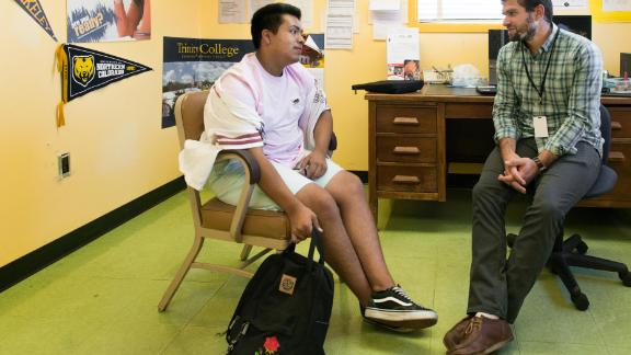 """Gerardo Alejandrez (left) meets with counselor Erich Roberts at Oakland Technical High School on Sept. 26, 2017. Alejandrez used to throw chairs, hit his classmates and curse at his teachers before enrolling at Oakland Tech. """"It was terrible times for me."""" (Heidi de Marco/KHN)"""