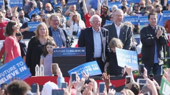 "NEW YORK, NY - APRIL 17:  Jane Sanders (2nd L), Democratic presidential candidate U.S Senator, Bernie Sanders (C), Levi Sanders (2nd R) and David Driscoll (R) attend, ""A Future To Believe in GOTV"" rally concert at Prospect Park on April 17, 2016 in New York City.  (Photo by Mireya Acierto/FilmMagic)"