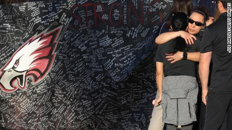 PARKLAND, FL - FEBRUARY 28:  People hug each other as students arrive at Marjory Stoneman Douglas High School for the first time since the shooting that killed 17 people on February 14  at the school on February 28, 2018 in Parkland, Florida.  Police arrested 19-year-old former student Nikolas Cruz for the 17 murders.  (Photo by Joe Raedle/Getty Images)
