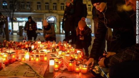 Slovak mourners light candles for the murdered couple.