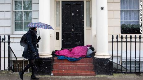 A homeless person sleeps in a doorway in London during a cold snap in February 2018.