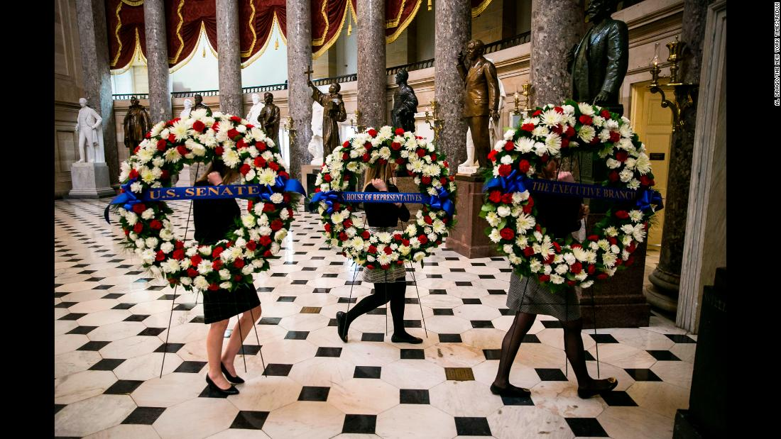 Wreaths are carried through the National Statuary Hall as setup begins at the Capitol on Tuesday, February 27.