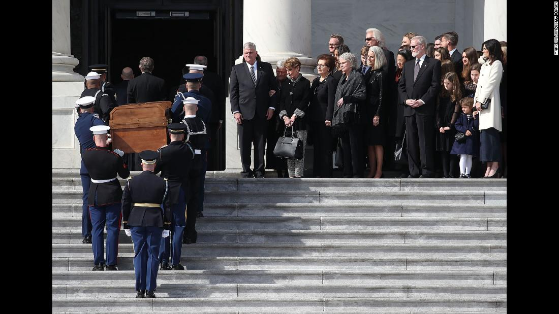 Graham's family and friends watch the honor guard enter the Capitol.