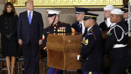 U.S. President Donald Trump and first lady Melania Trump watch Christian evangelist and Southern Baptist minister Billy Graham's casket arrive in the U.S. Capitol Rotunda February 28, 2018 in Washington, DC. A spiritual counselor for every president from Harry Truman to Barack Obama and other world leaders for more than 60 years, Graham died February 21 at the age of 99.  (Chip Somodevilla/Getty Images)