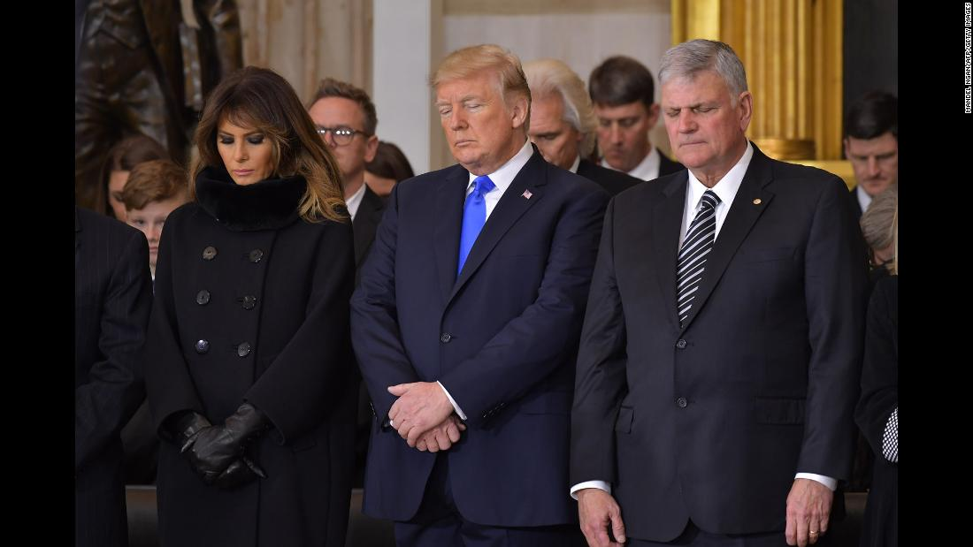 President Trump is flanked by his wife, Melania, and Franklin Graham at the Capitol's memorial service on February 28.