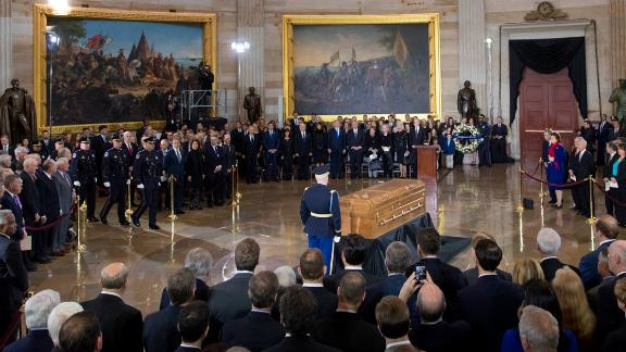 """The body of Rev. Billy Graham, who died last week at age 99, lies in the Capitol Rotunda as President Donald Trump, officials and dignitaries pay tribute to America's most famous evangelist, Wednesday, Feb. 28, 2018, in Washington. The North Carolina-born farm boy became a media-savvy Southern Baptist minister and spiritual adviser to numerous presidents, reaching millions around with the world with his rallies — or what he called """"crusades"""" — through his pioneering use of television. (AP Photo/J. Scott Applewhite)"""
