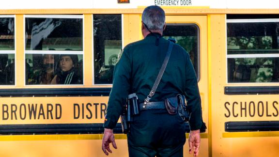 epa06570350 A police officer on duty the Marjory Stoneman Douglas High School entrance as parents and students arrive at the High School in Parkland, Florida, USA, 28 February 2018, for the school's reopening, two weeks after the mass shootings at the school. The shooting at Marjory Stoneman Douglas High School in Parkland, Florida left 17 people dead.  EPA-EFE/CRISTOBAL HERRERA