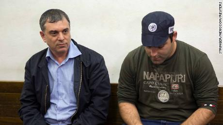 Shlomo Filber (L) sits in court during his remand in Tel Aviv on February 18.