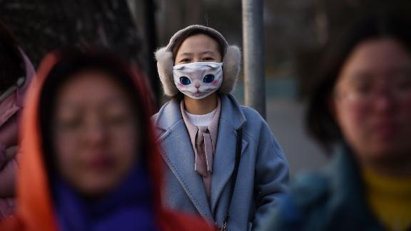 A woman wears a mask in Beijing