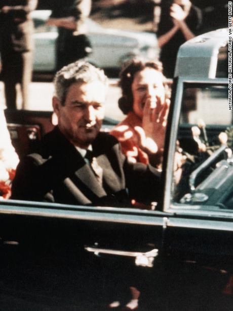 Prior to the assassination, President John F. Kennedy, First Lady Jacqueline Kennedy, and Texas Governor John Connally ride through the streets of Dallas, Texas on November 22, 1963. Included as an exhibit for the Warren Commission. (Photo by © CORBIS/Corbis via Getty Images)