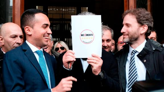 Five Star Movement (M5S) leader Luigi Di Maio (L) jokes with movement's founders Beppe Grillo (hidden) and Davide Casaleggio (R) outside the Interior Ministry on January 19, 2018 after they registered their logo for the upcoming general elections to be held on March 4, 2018.  / AFP PHOTO / ANDREAS SOLARO        (Photo credit should read ANDREAS SOLARO/AFP/Getty Images)